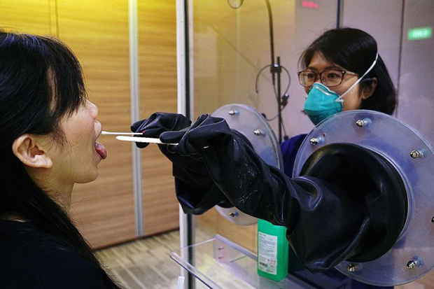 ​Throat swabs being done with SG Safe (above), a transparent booth system  PHOTO SGH