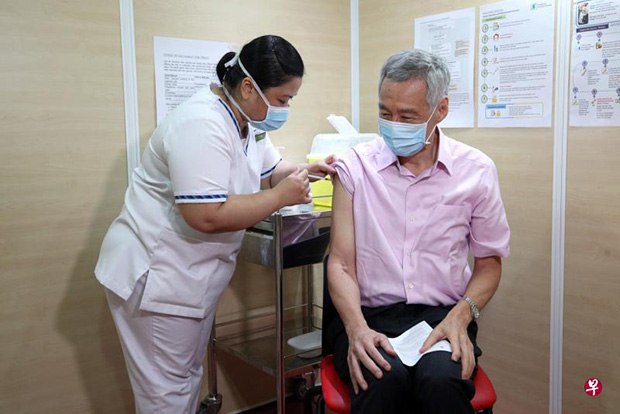 Prime Minister Lee Hsien Loong receiving his second dose of the Covid-19 vaccine at the Singapore General Hospital yesterday. It was administered by senior staff nurse Fatimah Mohd Shah, who had given him the first dose.PHOTO MCI
