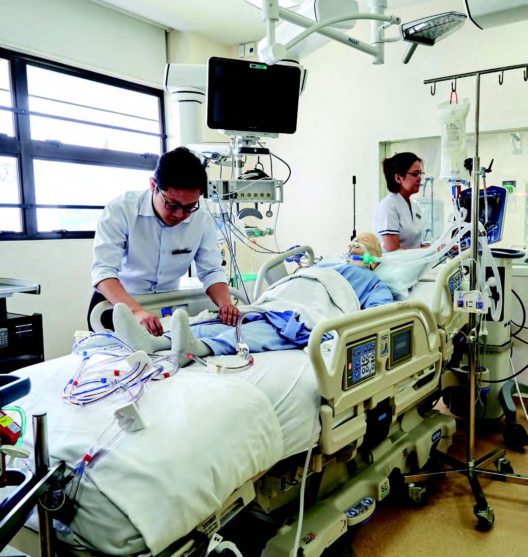 Dr Sewa Duu Wen sets up the extracorporeal membrance oxygenation (ECMO) machine on a mannequin. ECMO delivers oxygen into the bloodstream without injuring the lungs.
